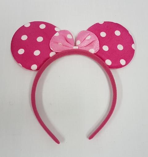 Pink polka dot mouse ears on headband