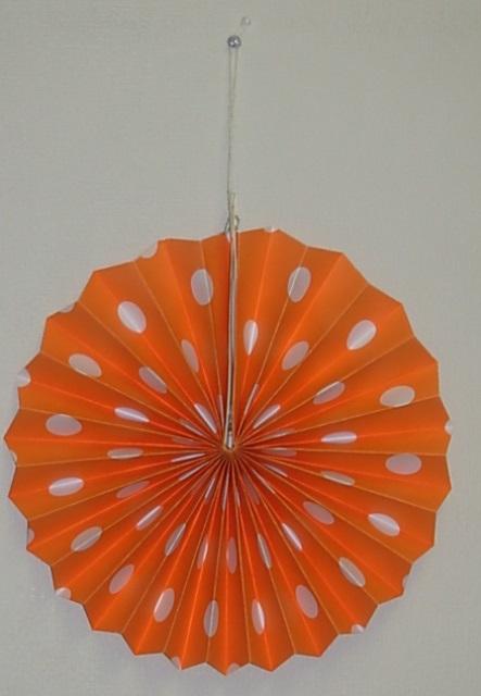 Orange polka dot fan decoration